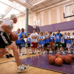 Dallas-Mavericks-Hoops-Camp-Teaching-Passing-to-Campers.jpg