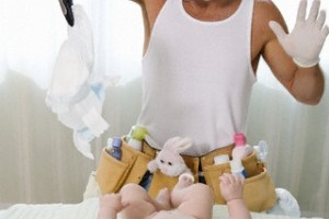 Father Changing Baby's Diaper