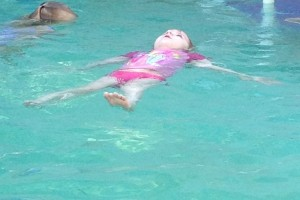 Chloe floating at survival swim lessons.