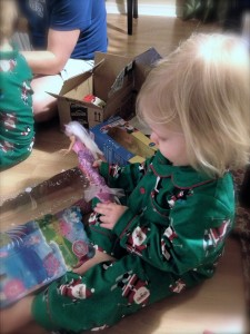 Toddler opening a Barbie