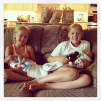 Mommy's helpers smitten with the twin-littles