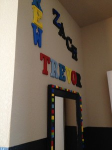 All three of the boys names and my LEGO mirror are what you see first when you enter the room.