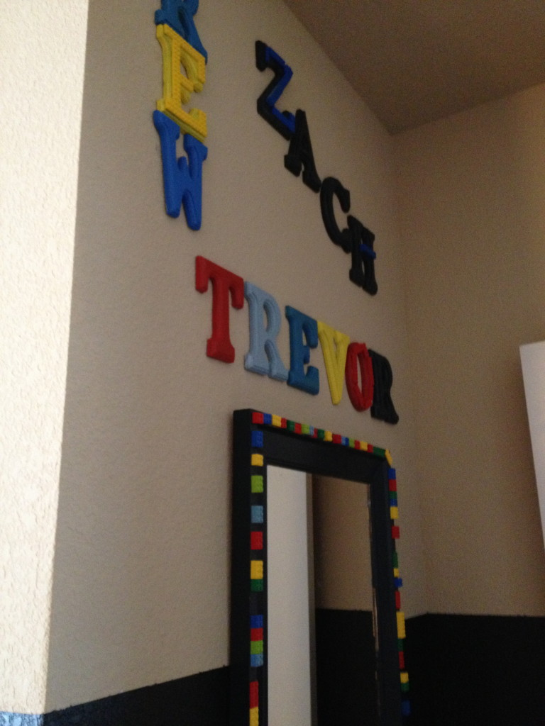 All three of the boys names and my LEGO mirror are what you see first when  you enter the room. How to Make a Fabulous DIY LEGO Room