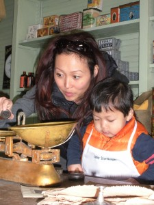 Playing shopkeeper at the General Store. Photo compliments of Dallas Heritage Village.