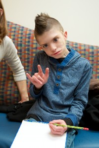 Christian showing his half smile at the Craniofacial Center at Sea Children's