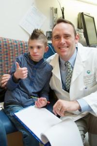 Christian with Dr. Birgfeld at the Craniofacial Center at Sea Children's