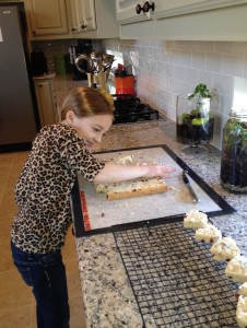 making cranberry shortbread cookies for her classmates