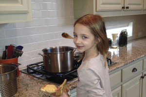 Making mushroom-barley soup with prosciutto, practically by herself.
