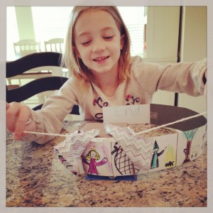 With fewer structured activities, my oldest daughter's creativity has flourished! She made a theater out of cardboard, fabric, colored pencils and string. Love!