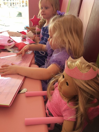 I am done with birthday parties - my daughter at American Girl with friends for her birthday.