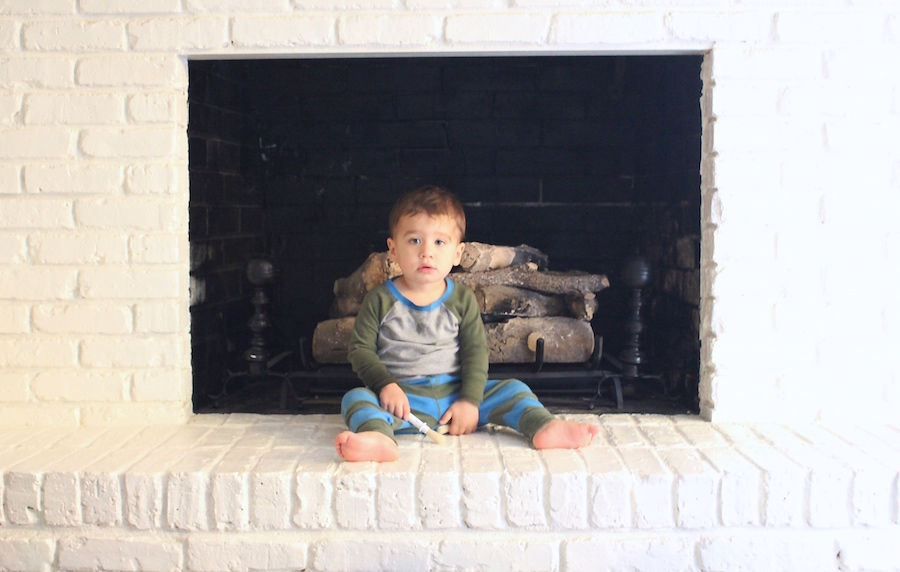 Teaching children to respect boundaries takes time. He is not allowed on the fireplace, but clearly this is still a work in progress.