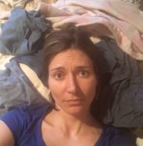This hot mess mom laying on top of laundry mountain!