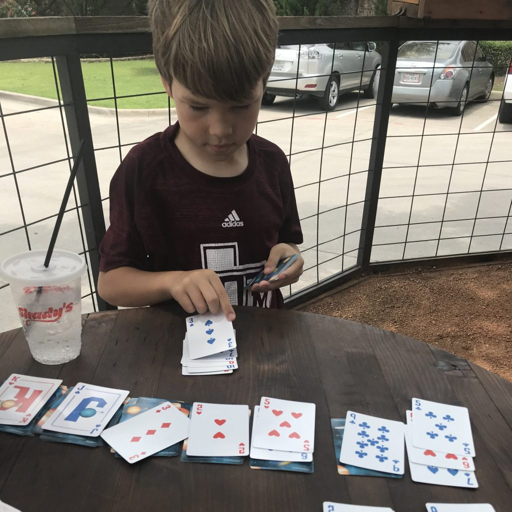 Boy play solitaire